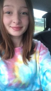 girl in EV Designs Tiedye tee